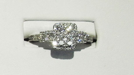 14 kt white gold beautiful dinner ring with 2.61 total carats of diamonds. Includes 2 rows of round brilliant diamonds on the outside rows  and the middle row of baguette diamonds.