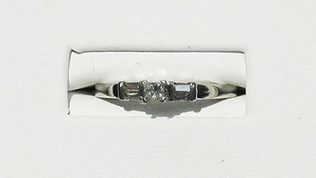 10kt  white gold engagement ring with a square diamond on the top and baguette diamonds on the sides, approximately .5 carats of diamonds.