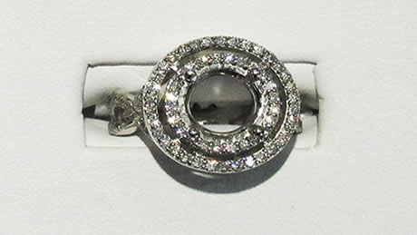 18 kt white gold ring with 2 circular designs with brilliant small diamonds, approximately .5 carats.